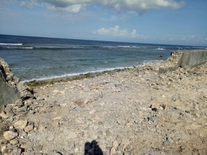 Project operator has been stopped after demolishing seawall without any permission to build beach club at Senderan Beach, Nusa Penida.